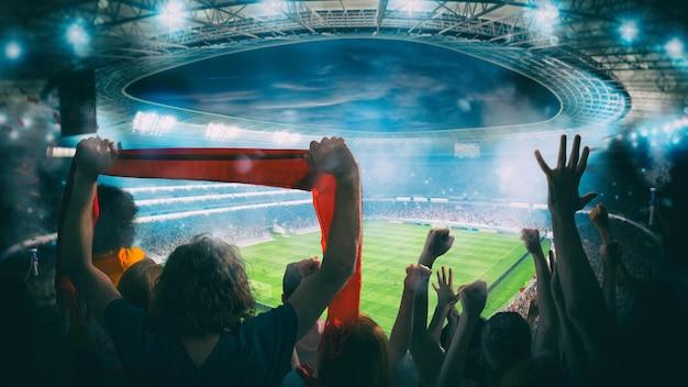 Festliches publikum im stadion während eines spiels