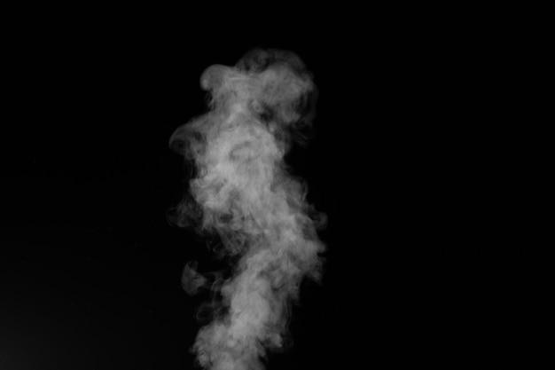 Figured rauch auf einem dunklen hintergrund. abstrakter hintergrund, gestaltungselement, zur überlagerung von bildern.