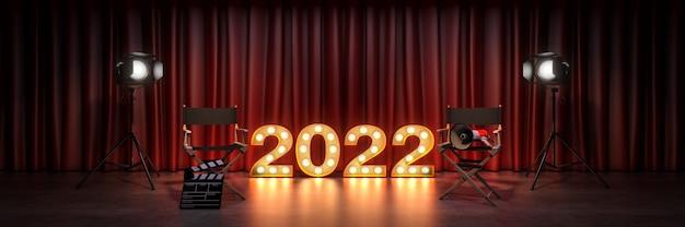 Filmkinokonzept festzelt licht 2022 buchstabenzeichen direktorenstuhl und filmklappe