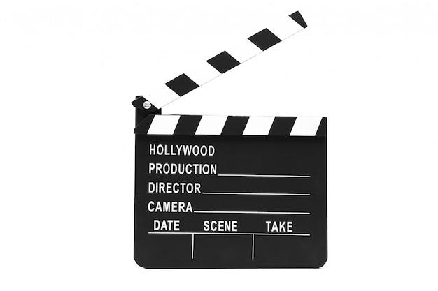 Filmschiefer, der gegen weißen hintergrund steht