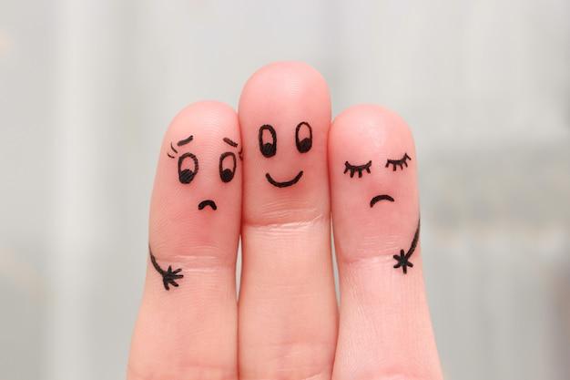 Finger-kunst. glücklicher mann umarmt zwei frauen, die es nicht mögen.