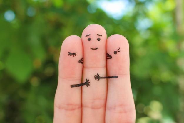 Finger kunst. konzept der mädchen küsst jungen auf wange.
