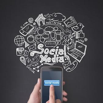 Fingerdrücken eines smartphones mit social-media-konzept