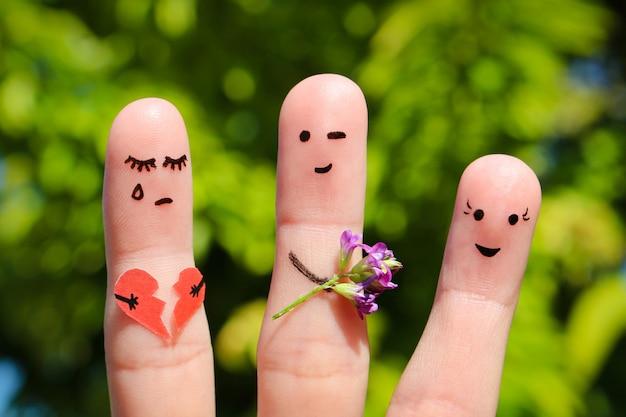 Fingerkunst der menschen. mann flirtet mit frau. anderes mädchen hält gebrochenes herz