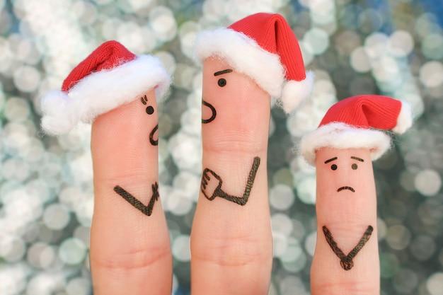 Fingerkunst des paares feiert weihnachten. konzept des mannes und der frau während des streites im neuen jahr, kind ist gestört.