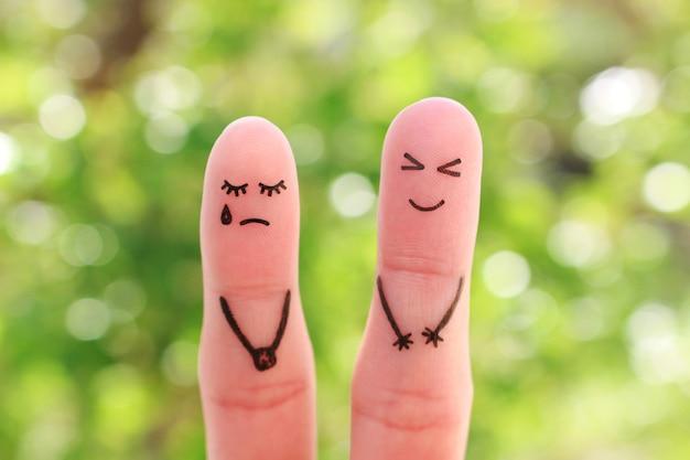 Fingerkunst des paares. frau weint, mann lacht.