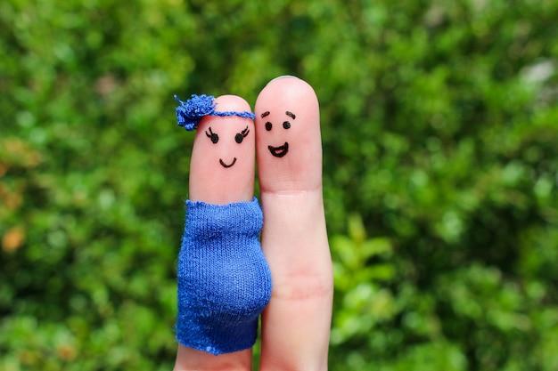 Fingerkunst eines glücklichen paares. frau ist schwanger.