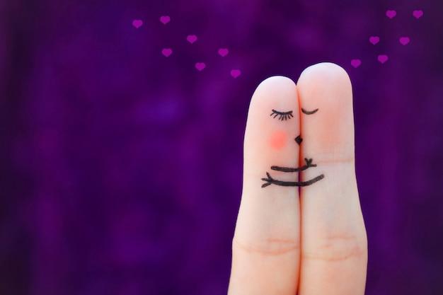 Fingerkunst eines glücklichen paares. paar küssen und umarmen