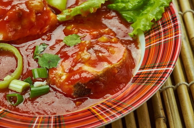 Fisch makhani, ein rotes curry aus buttermasala oder makhani.
