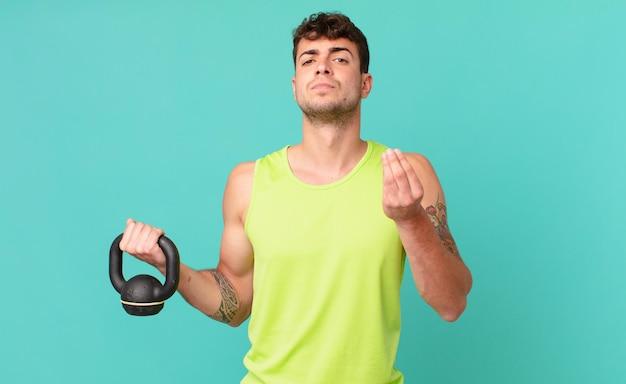 Fitness-mann, der capice oder geldgeste macht und ihnen sagt, dass sie ihre schulden bezahlen sollen!