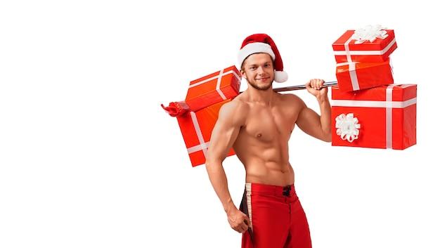 Fitte den nackten weihnachtsmann mit einer langhantel voller geschenke