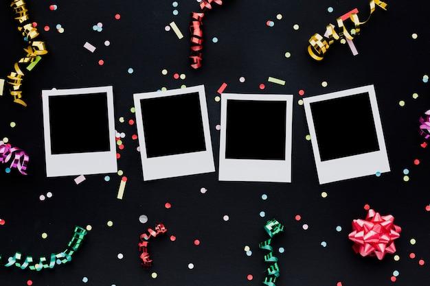 Flachbettdekoration mit fotos und konfetti