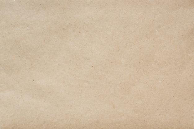 Flache handwerksöko-papierhintergrundbeschaffenheit. platz für text, schrift, kopie.