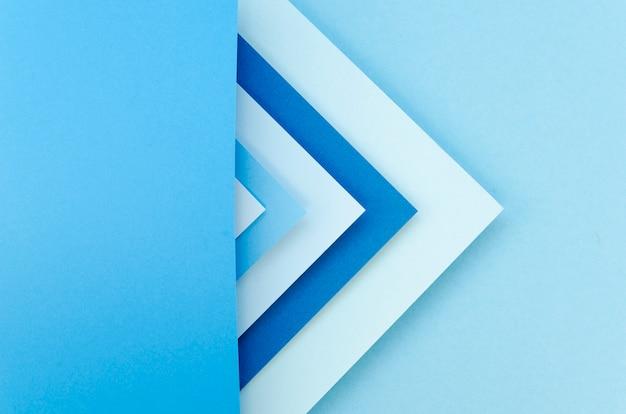 Flache lage der bunten papiergeometrie mit kopienraum