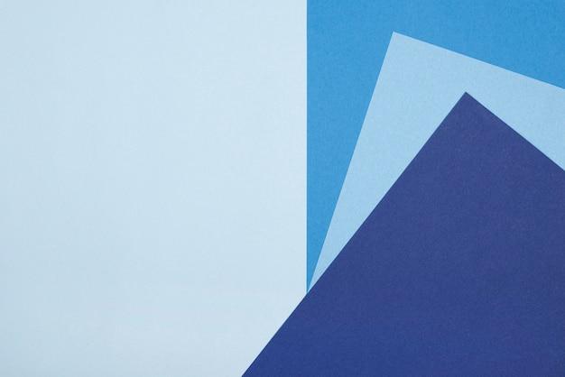 Flache lage des blauen montagpapiers mit kopierraum