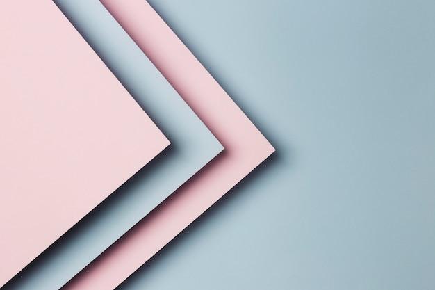 Flaches lay-sortiment von mehrfarbigem papierblatthintergrund