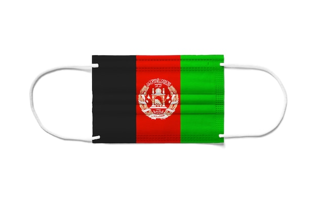 Flagge afghanistans auf einer chirurgischen einwegmaske