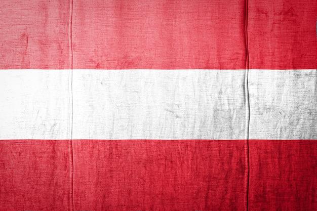 Flagge auf stoff textur hintergrund.