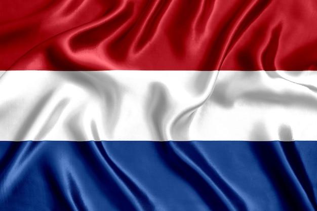 Flagge der niederländischen seidennahaufnahme