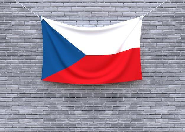 Flagge der tschechischen republik, die an der backsteinmauer hängt