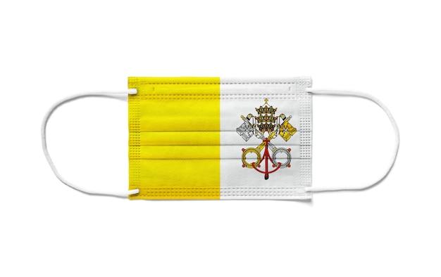 Flagge der vatikanstadt auf einer chirurgischen einwegmaske