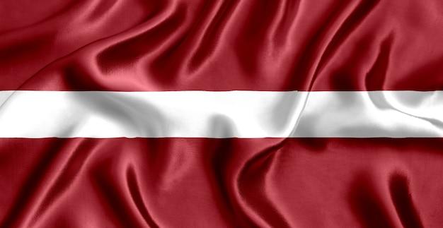 Flagge des lettischen seiden-nahaufnahmehintergrunds