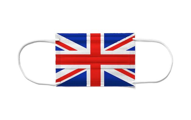 Flagge des vereinigten königreichs, großbritannien, auf einer chirurgischen einwegmaske. weißer hintergrund isoliert