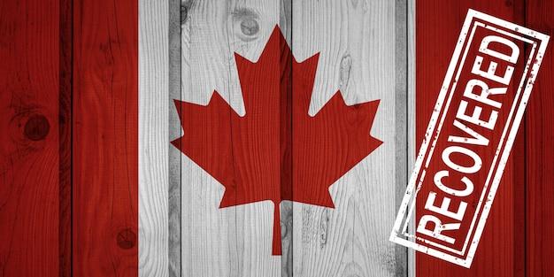 Flagge kanadas, die die infektionen der corona-virus-epidemie oder des coronavirus überlebt oder sich davon erholt hat. grunge-flagge mit stempel wiederhergestellt