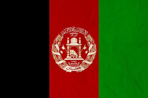 Flagge von afghanistan mit alter papierbeschaffenheit der weinlese