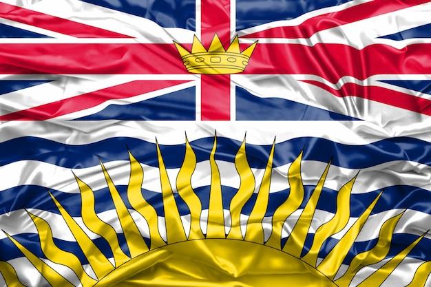 Flagge von britisch-columbia-staat kanada auf weicher und glatter seidenbeschaffenheit