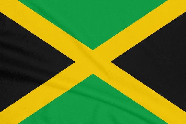 Flagge von jamaika auf strukturiertem gewebe, patriotisches symbol