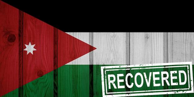 Flagge von jordanien, die die infektionen der corona-virus-epidemie oder des coronavirus überlebt oder sich erholt hat. grunge-flagge mit stempel wiederhergestellt