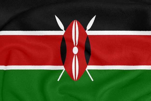 Flagge von kenia auf strukturiertem gewebe. patriotisches symbol