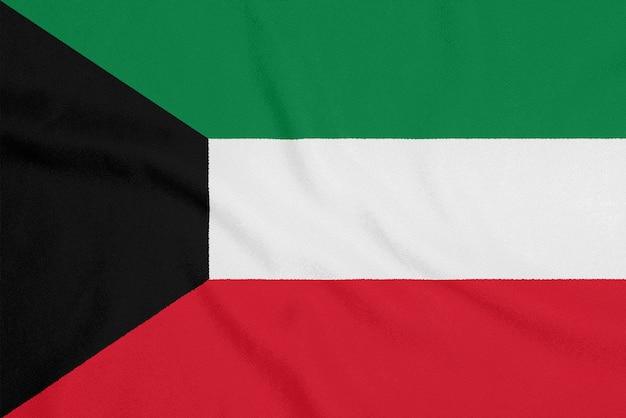 Flagge von kuwait auf strukturiertem gewebe.