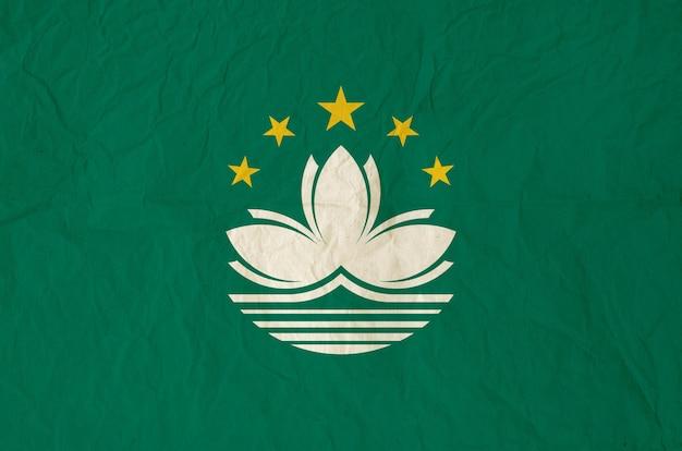 Flagge von macau mit alter papierbeschaffenheit der weinlese