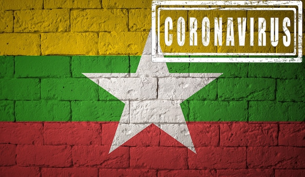 Flagge von myanmar oder burma mit ursprünglichen proportionen. gestempelt mit coronavirus. mauer textur. konzept des corona-virus. am rande einer covid-19- oder 2019-ncov-pandemie. Premium Fotos