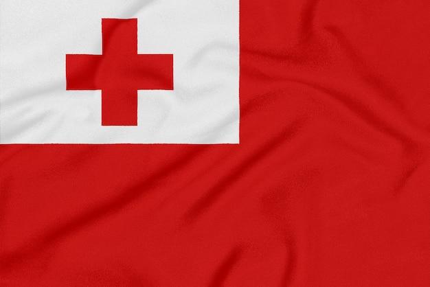 Flagge von tonga auf strukturiertem gewebe. patriotisches symbol