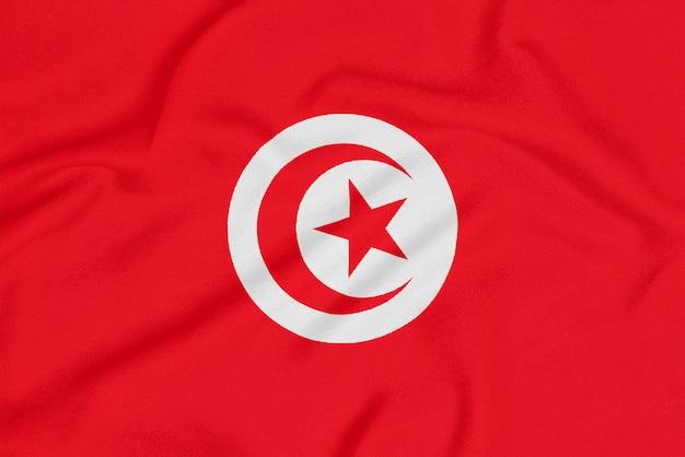 Flagge von tunesien auf strukturiertem gewebe.
