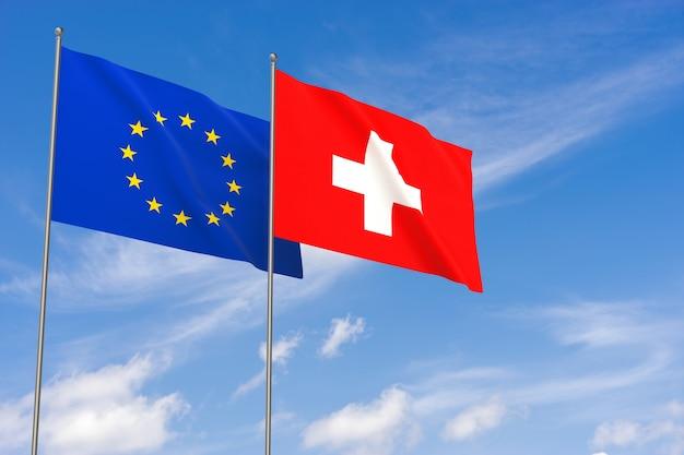 Flaggen der europäischen union und der schweiz über blauen himmelshintergrund. 3d-darstellung
