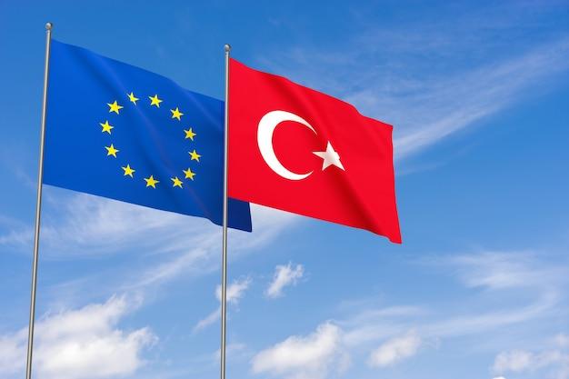 Flaggen der europäischen union und der türkei über blauen himmelshintergrund. 3d-darstellung