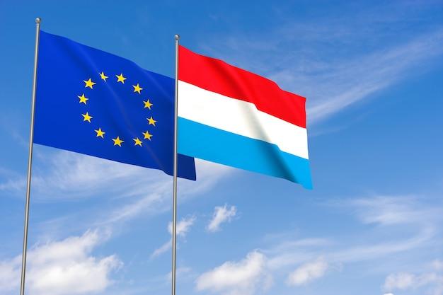 Flaggen der europäischen union und luxemburgs über blauem himmelshintergrund. 3d-darstellung