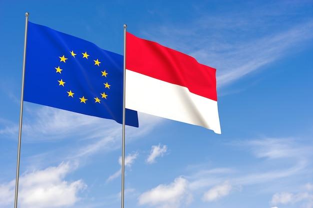 Flaggen der europäischen union und monaco über blauen himmelshintergrund. 3d-darstellung