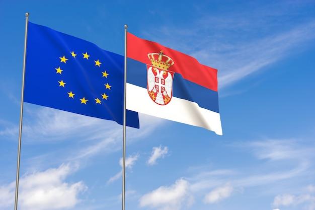 Flaggen der europäischen union und serbiens über blauem himmelshintergrund. 3d-darstellung