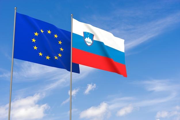 Flaggen der europäischen union und sloweniens über blauem himmelshintergrund. 3d-darstellung