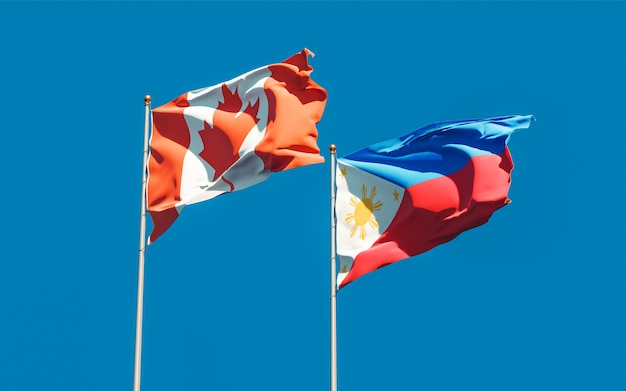 Flaggen der philippinen und kanadas. 3d-grafik