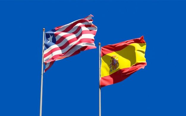 Flaggen von liberia und spanien. 3d-grafik