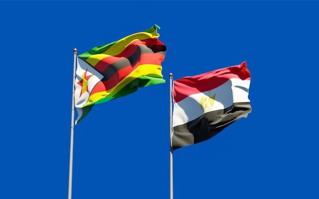 Flaggen von simbabwe und ägypten. 3d-grafik