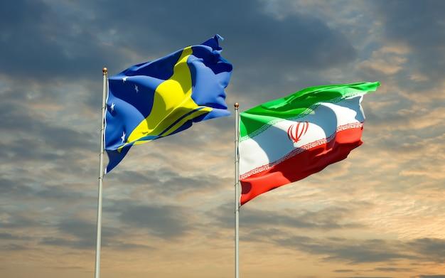 Flaggen von tokelau und iran. 3d-grafik