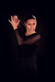 Flamenco-frau mit schwarzem kleid und klatschen