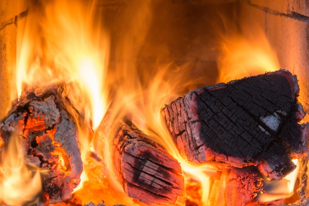 Flammen im ofen, brennholz. muster. feuer.